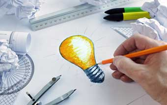 Drawing of a lightbulb symbolizing invention.